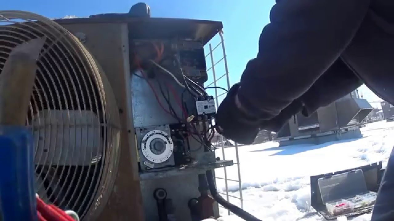 Troubleshoot a rooftop condensing unit to a walk in cooler