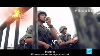 China's military warns Hong Kong protesters with propaganda video