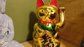 Maneki-neko Lucky Cat waves you good luck