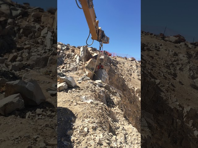 4G - Using an excavator with breaker attachment to remove pieces of rubble