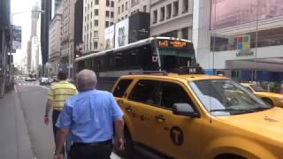 Repeat youtube video MTA Bus Service: Triple MCI MTA Express Buses Cruising By On E 52nd St & 5th Ave