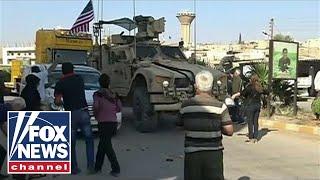 Kurdish protesters throw food, rocks at retreating US military