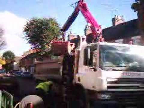 Truck With HMF 1144 Loading Crane Closer