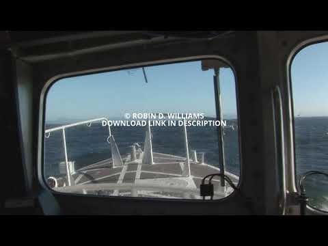 Interior window view of ocean with bow from Pilot boat underway