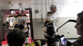 Boston Bruins- Behind Scenes- players exit locker room to meet Courtney as she High Five