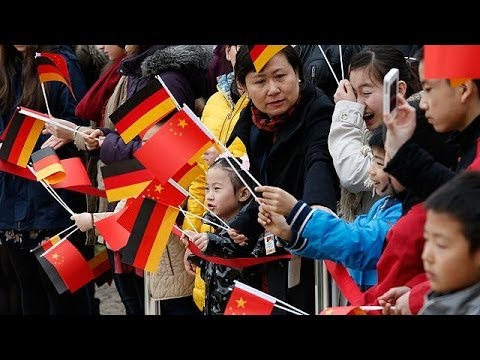 Merkel warns China's Xi Jinping over free expression