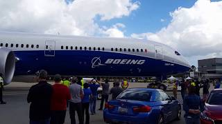 787-10 wingtip almost clipping a building when being towed.