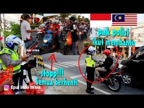 PAK POLISI AUTO BANTU BAGI NASI LEMAK MALAYSIA DI TRAFFIC LIGHTS/CEPAT HABISS GUYSS