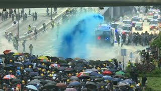Hong Kong police fire tear gas, water cannon at protesters | AFP