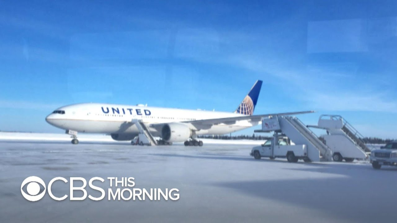 Stranded United passengers spend the night on jet after plane diverted
