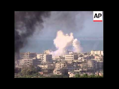 WRAP Heavy fighting continues in refugee camp, shelling; ADDS more shots