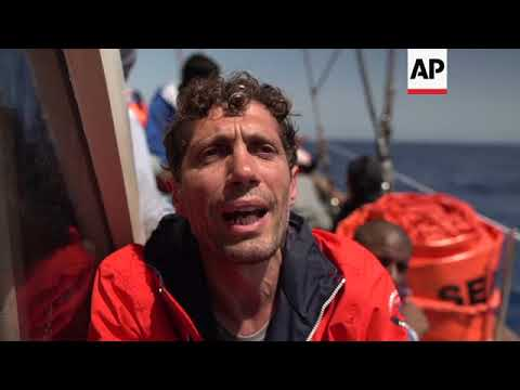 Rescued migrants stuck on boat as Italy...