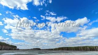 Clouds over the lake. Last snow. Time Lapse