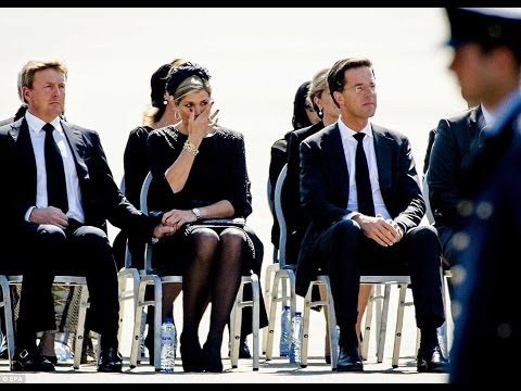 Dutch Royals and Grieving Relatives Watch as First Bodies Arrive Back in Holland