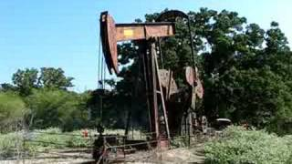 Old Oilwell Pumping In Bryan, Texas thumbnail
