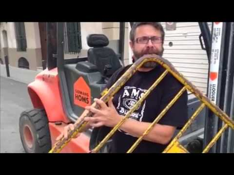 Francesc-Xavier Lozano Palay plays a traditional folk song on a modified metal security barrie
