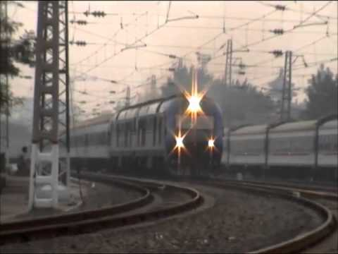 The Chinese railway diesel locomotive DF11G haul 25T passenger train depart BeiJing Station