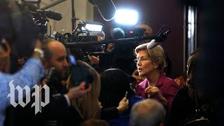 In the spin room, Warren slams Bloomberg yet again