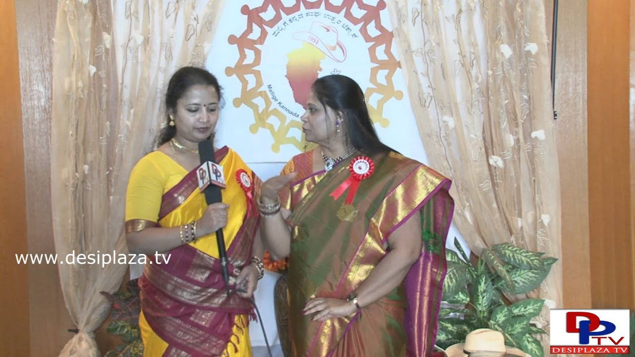 Vidya Datta, President of MKANT speaking to Desiplaza Tv at MKANT Kannada Rajyotsava in Dallas