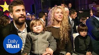 supporting each other shakira and sons cheer on gerard pique daily mail