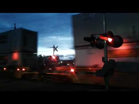 BNSF double stack train at MAIN STREET railroad crossing in the dark