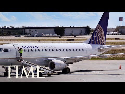 A Woman Screaming 'I Am God' Tried To Open A Plane Door During United Airlines Flight | TIME