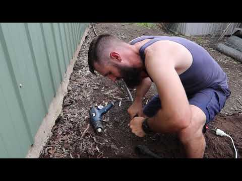 Plumb rainwater tank and bury pipes underground