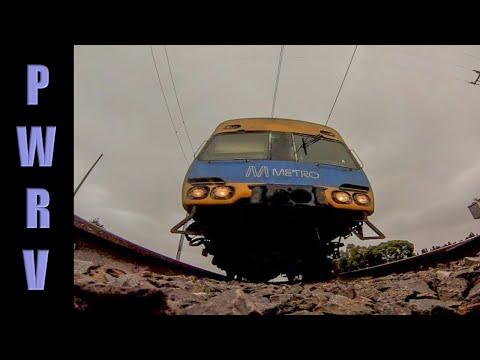 Train over camera - Metro Comeng e.m.u's Sunbury, Vic Australia