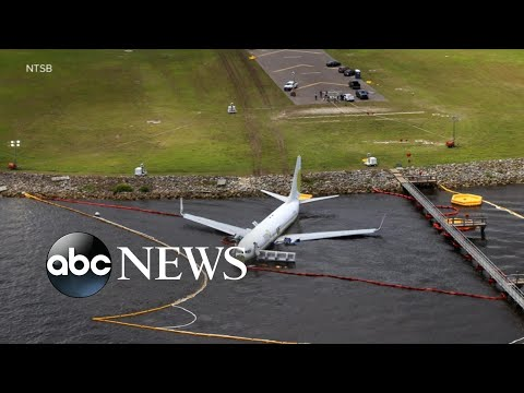 143 people rescued from plane that slid into a nearby river