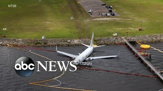 143-people-rescued-plane-slid-nearby-river