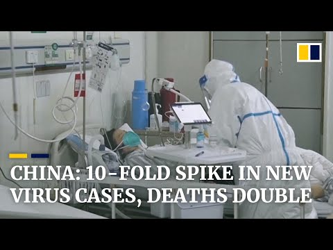 China's Hubei province reports huge spike in coronavirus cases, rising 10-fold from previous day