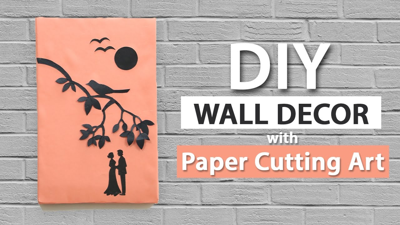Wall decor ideas from paper cutting art easy wall hanging for Room decoration from waste material
