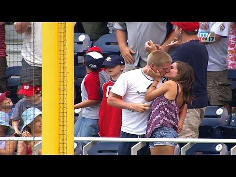 A fan catches Dunn's homer, gets a kiss