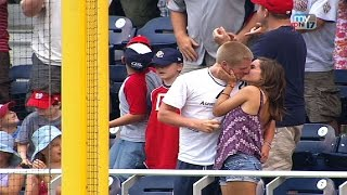 A fan catches Dunn's homer, gets a kiss