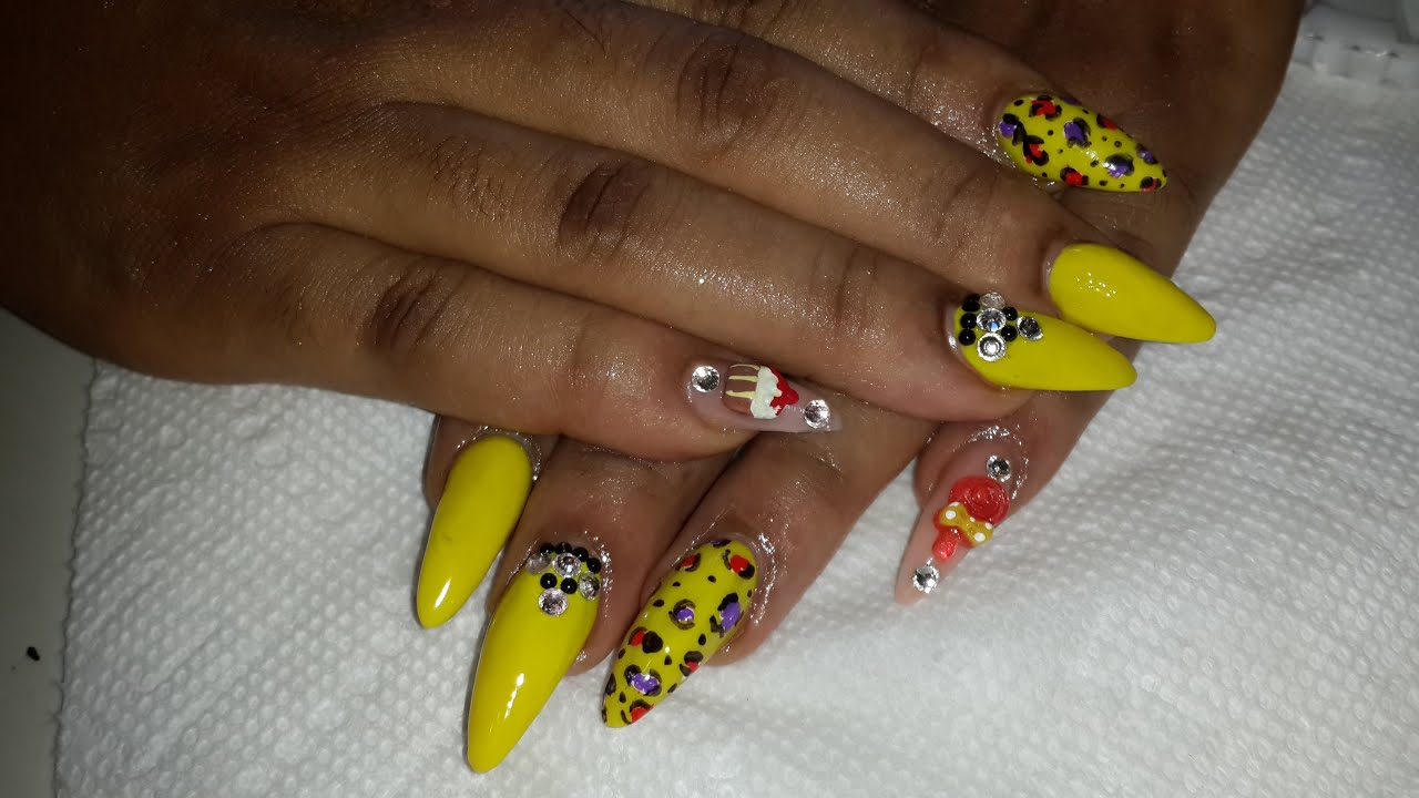 Yellow Stiletto Nails With 3D Candy