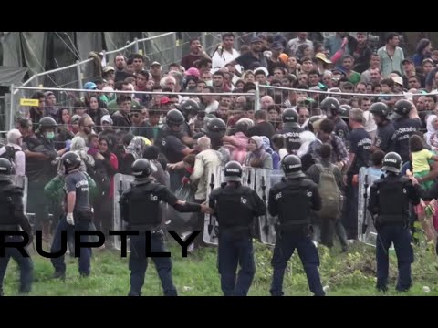 Riot police teargas refugees attempting to break out of detention camp in Hungary
