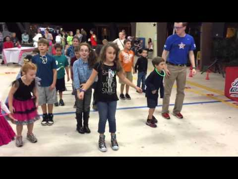 Luanda dancing at her new school