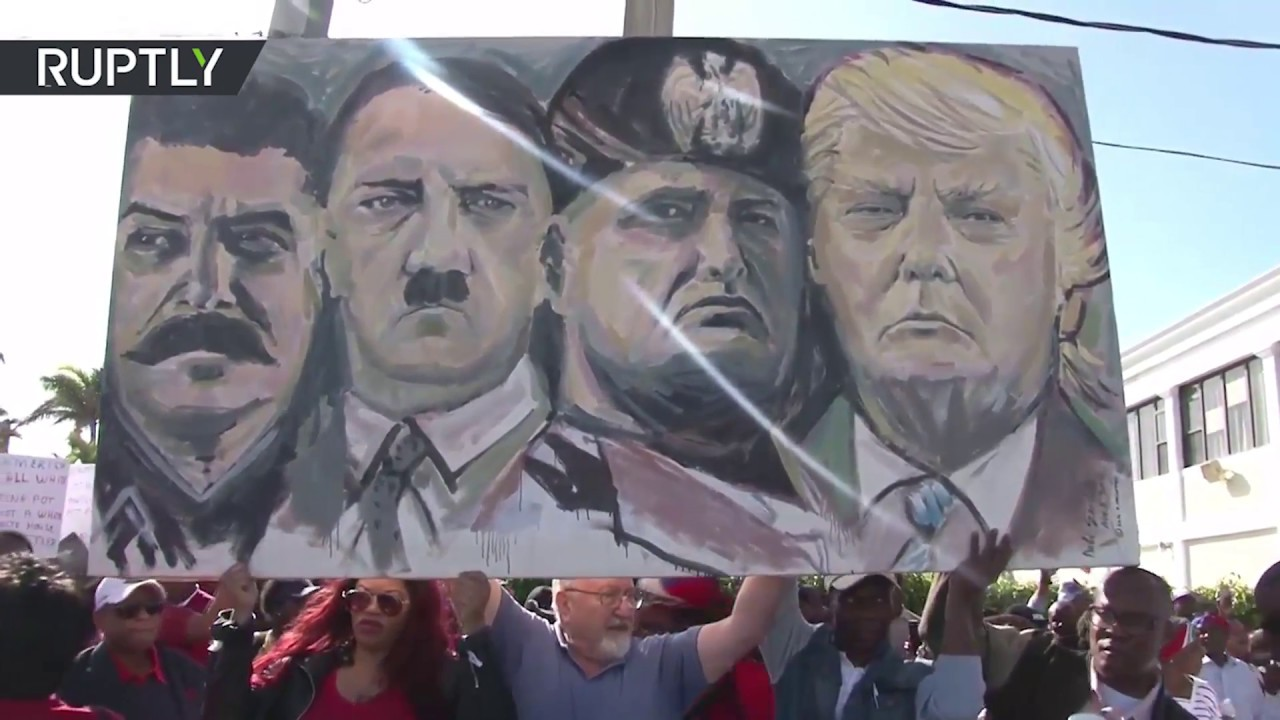 Haitians protest by Trump's Mar a Lago over alleged 's***hole countries' rant