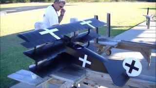 Chris flying his Balsa USA Fokker Tri-plane. G26 magneto engine.