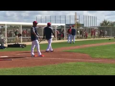 Red Sox coaches Ramon Vazquez and Carlos Febles hit grounders to infielders