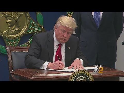 Trump Signs Order Suspending Refugee Program