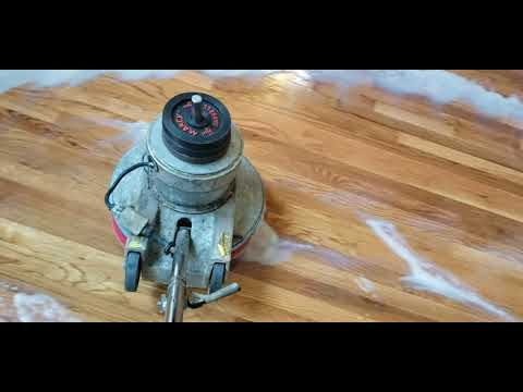 Removing wax from hardwood floors before new customer moves into their home