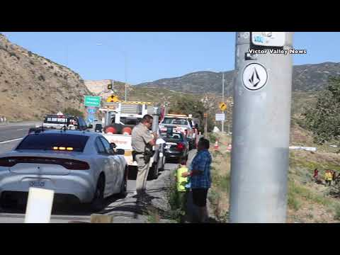 Semi hauling car loses breaks and crashes over side of 15 freeway #CajonPass