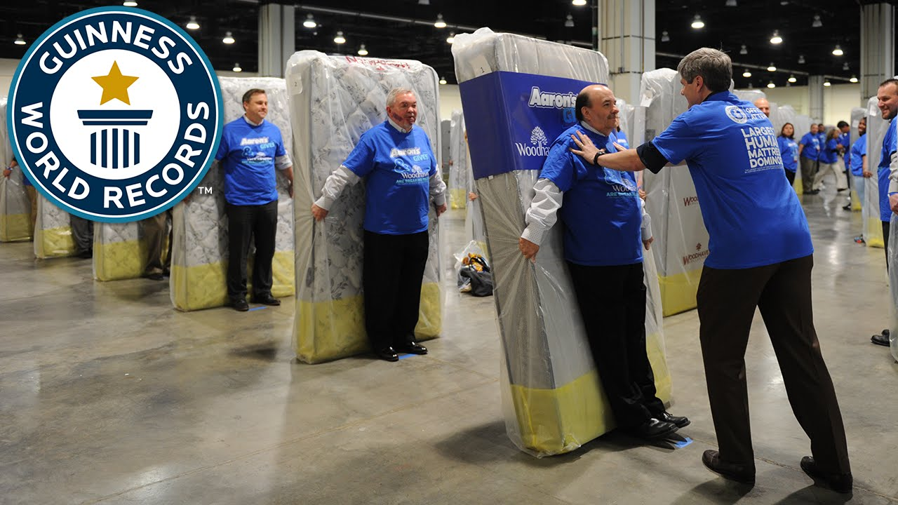 Largest Human Mattress Dominoes Guinness World Records Youtube