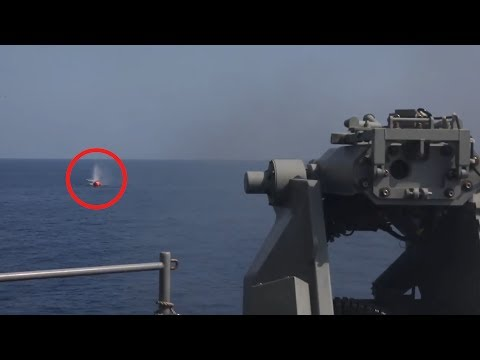 Watch a US Navy assault ship fire at an inflatable 'killer tomato'