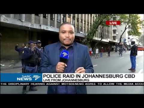 LIVE: Police raid hijacked building in Johannesburg CBD