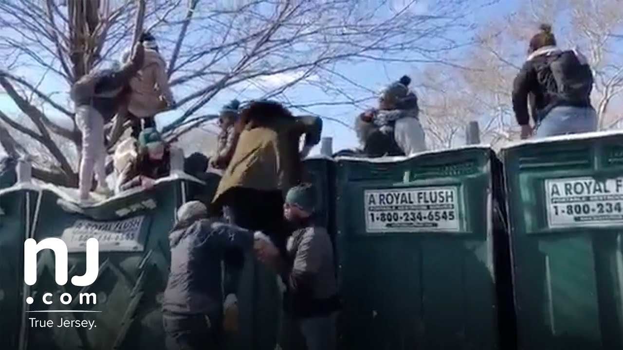 Fans Climb On Top Of Porta Potties During Eagles Parade Youtube