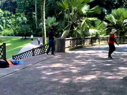 Singapore senior citizen having good time dancing at Botanical Gardens