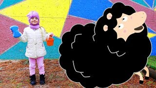 Ulya on the farm catches a black sheep