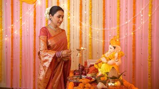 Aarti ceremony being done by the daughter-in-law of the Hindu family - Indian customs and rituals
